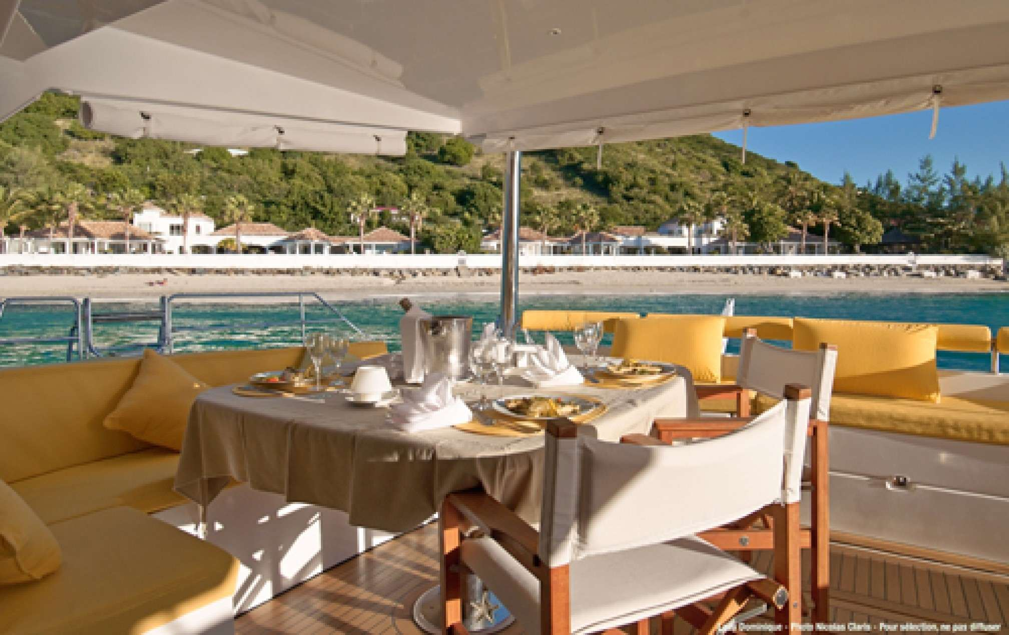 Lady Dominique II luxury catamaran charter deck table